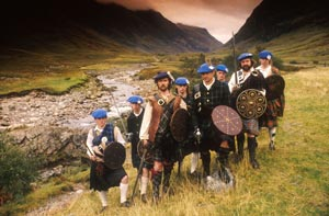 Members of the White Cockade Society pose for a photograph during a Jacobite re-enactment in Glen Coe.